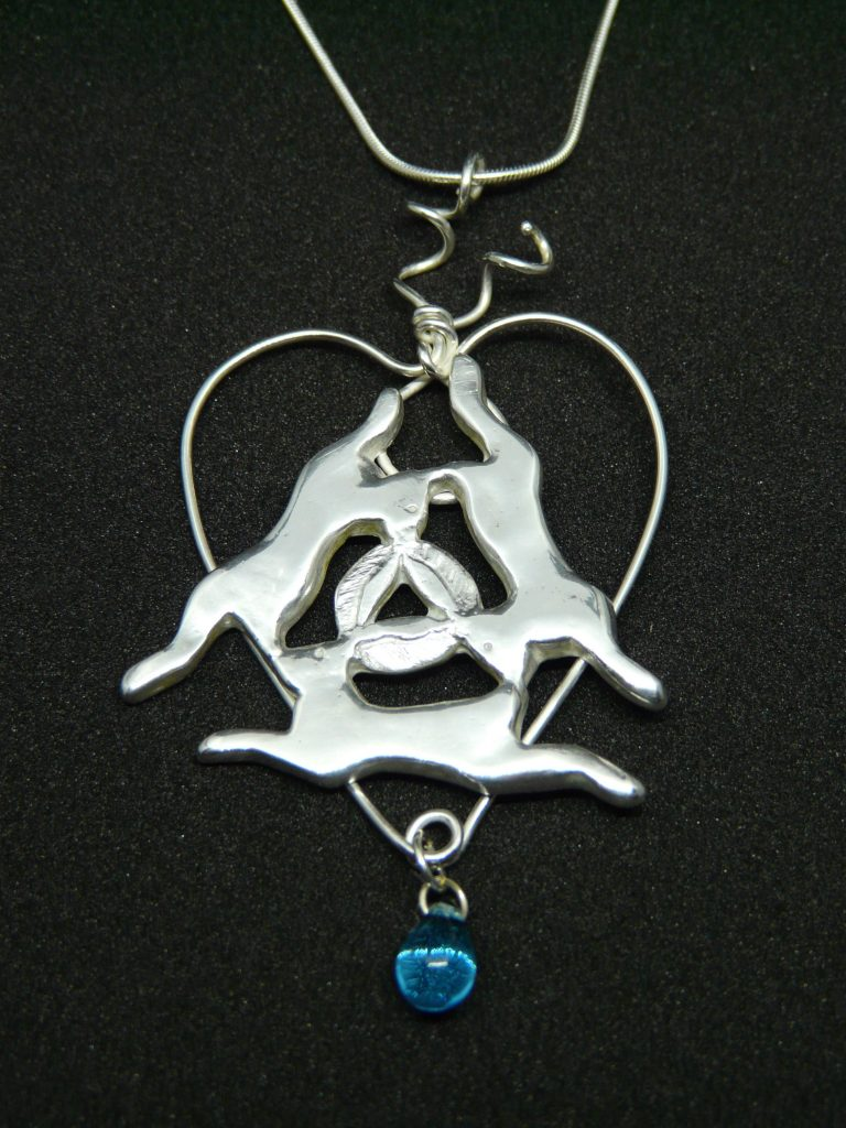 Silver trickle hares pendant
